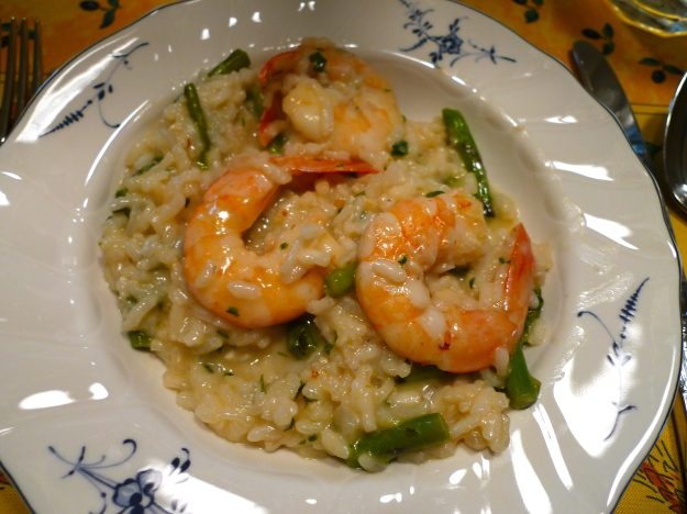 A perfect way to showcase jumbo Texas Gulf shrimp – simmered in wine and garlic and served over lemon asparagus risotto.